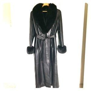 Full length black leather coat with fox fur trim.